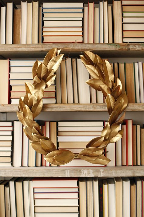 Tis the season to dress up your front door or mantel with something merry and festive. Create a DIY Gold Holiday Laurel Leaf