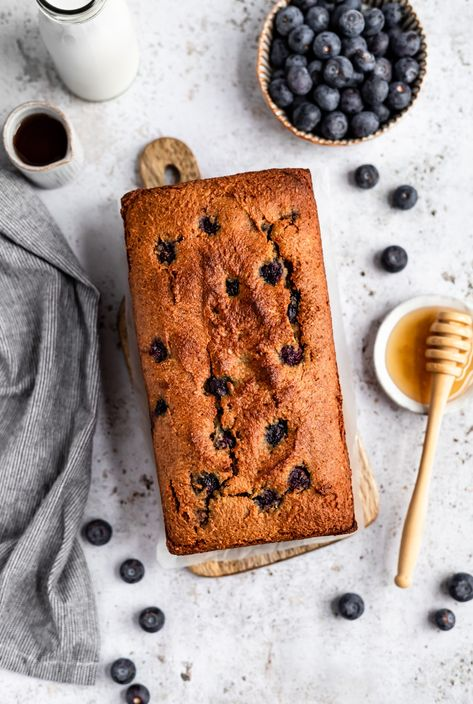 Gorgeous almond flour blueberry bread made in just one bowl and naturally sweetened with pure maple syrup. This easy gluten free blueberry bread is also grain free, dairy free and paleo and makes a wonderful breakfast or afternoon snack! Options to add lemon zest and poppyseeds for a fun, spring twist. #almondflour #blueberries #blueberryrecipe #bread #paleo #glutenfree #grainfree #dairyfree #paleobaking #breakfast #snack