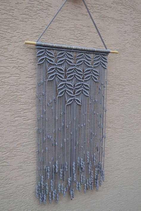 Wall panels handmade macramé technique. Material: 100% polyester. Color: light gray. Strap: natural wood - pine. Dimensions: The length of the strap to the bottom, including the thread - 71cm / 28 inches Width - 37cm / 14.6 inches
