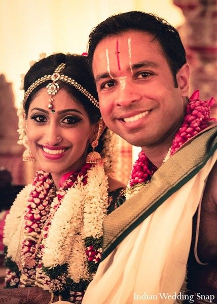 An Indian Couple Partake In Traditional Tamil Wedding Ceremonies