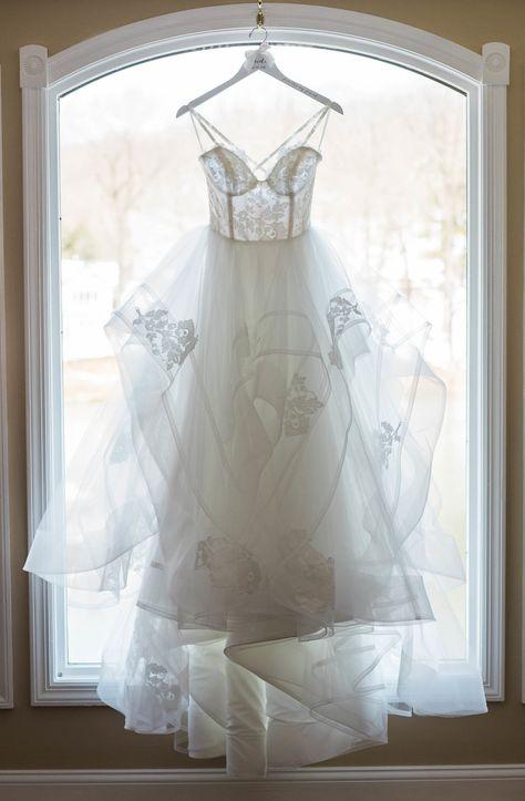Wedding dress hanging in the window at lakefront wedding venue in Northern New Jersey | Photographer: Priscilla de Castro