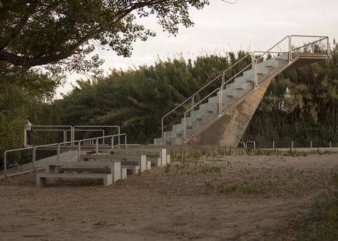 This concrete staircase into the air by Lisbon architecture studio Ateliermob functions as a riverside amphitheatre.
