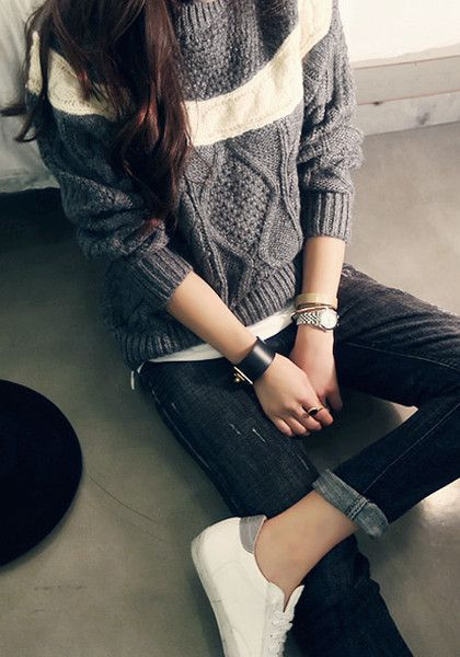 Create a sporty chic look with this cable knit sweater by teaming it with fitted pants and a pair of tennis shoes.