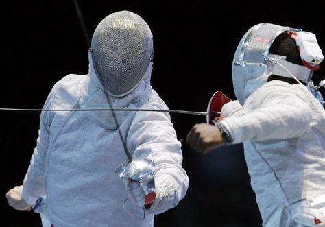 Alexey Yakimenko of Russia, left, and United States' Daryl Homer, compete during a quarterfinal match at men's team saber fencingat the 2012 Summer Olympics,