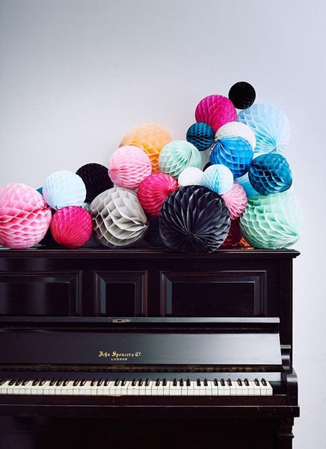 tissue globes on the piano. A colorful party display.