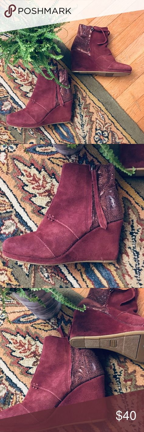 """TOMS Wedge Boot Sz 6 Maroon Side Zip TOMS Wedge Boot Sz 6 Maroon Side Zip.  These are suede leather with coordinating textured leather on back of boots.  Side zip with leather string tassels.  Such a great look!  These are in good condition.  Some signs of wear but nothing extreme or real noticeable while being worn.  3.5"""" Wedge. Toms Shoes Ankle Boots & Booties"""