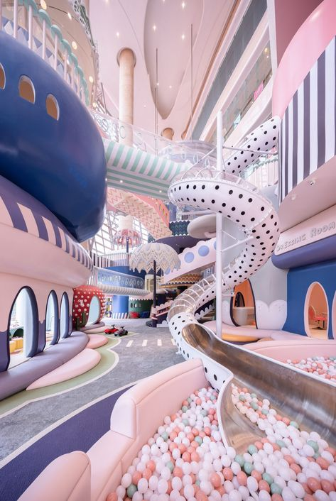 A polka-dot slide into a ball pit and giant pastel parasols feature in a fantastical miniature city called Shenzhen Neobio Family Park, by X+ Living.
