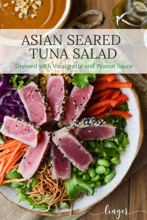 Crunchy Asian Seared Tuna Salad with Peanut Sauce is brimming with color, texture, and flavor. This recipe is healthy and super simple to throw together. The tuna is like butter that melts in your mouth. Asian Vinaigrette and Peanut sauce top this salad with yumminess. #searedtuna #asiansalad #salads #tunasalads #maindishsalads