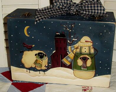 Snow scene painted on a small suitcase By Pat Sergent