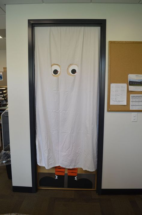 Just a shower curtain and construction paper make this door extra creepy for a Residence Hall at Halloween!