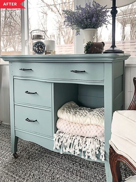 After: Painted blue dresser with folded blankets in open cubby