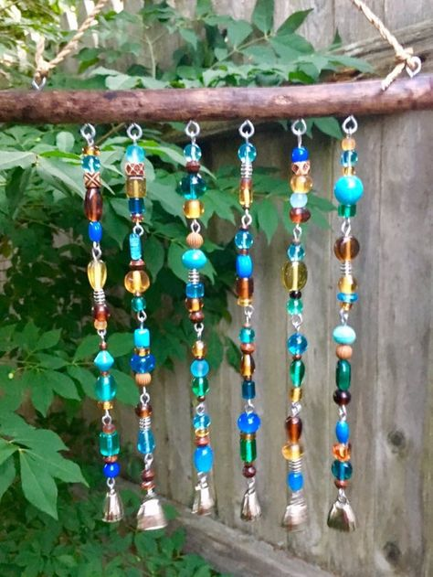 """These one of a kind driftwood beaded chimes were created from driftwood, I collect on the coast of downeast Maine. This beautiful ocean weathered wood measures 9"""" across. It has been cleaned and treated to protect it for longevity. The heavy glass beads, in shades of amber and teal, are a gorgeous"""