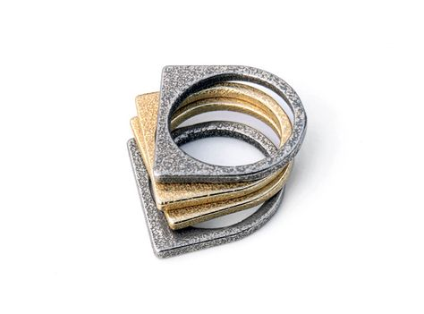 Different layers build a personality. Sometimes a shiny gold inside is covered by layers of cold steel.  This rings can be used with two or more layers. It looks great when mixed with other materials like gold. Stainless steel and gold plated rings, manufactured via Shapways 3D printing service.