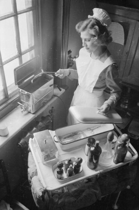 Sister Trotter sets sterilised instruments out on a tray, ready to take to the doctors on their rounds at Park Prewett Hospital in Basingstoke. 1941.