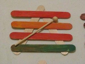 Making craft stick xylophones in preschool
