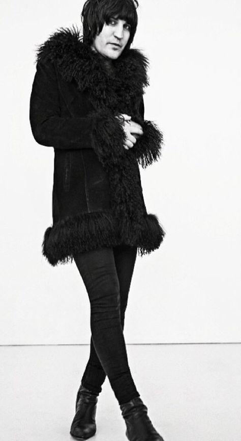 Furry coat & skinny pants.