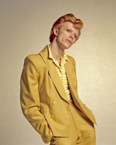 English singer, musician and actor David Bowie with dyed red hair and a mustard yellow suit photographed for a magazine in Los Angeles in The Script, Martin Scorsese, Glam Rock, David Bowie Poster, Andy Warhol, David Bowie Fashion, David Bowie Pictures, Yellow Suit, Dyed Red Hair