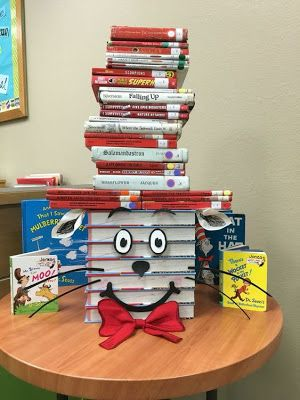 Read Across America Week! Our library celebrated Dr. Seuss with this Cat in the Hat display! It was made with books, foam accents, paper ears, and a felt tie. Best Picture For dr seuss week For Your T School Library Displays, Elementary School Library, Library Themes, Library Ideas, Library Week, School Libraries, Classroom Displays, Library Books, Elementary Library Decorations