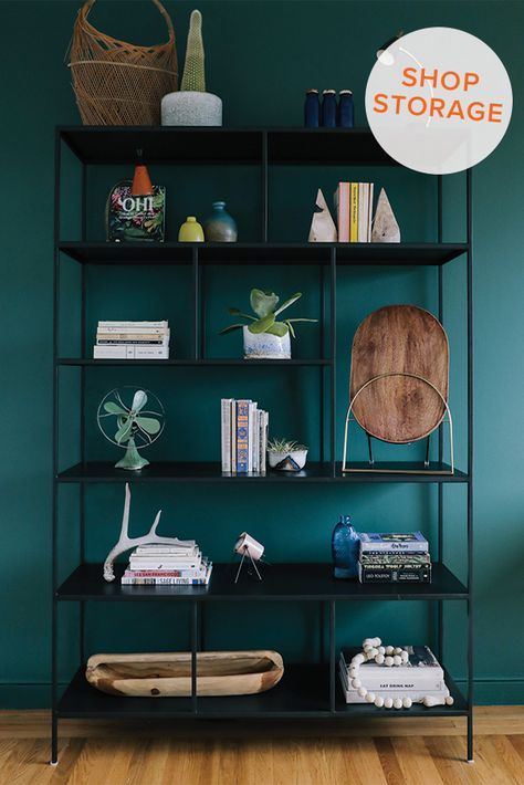 Bookcases can help divide a room, create a focal point or add organization. We love how Chloe Roth styled this Foshay shelving unit. Find a modern storage solution for any space in a variety of materials from steel to wood. Photographer: Andrea Posadas @andreapcreative