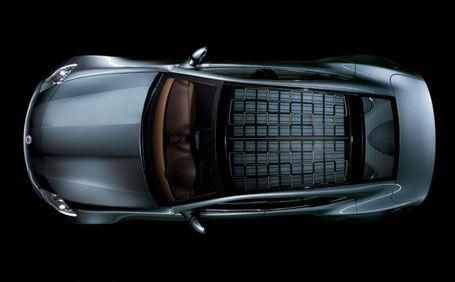 The World S Largest Seamless Solar Glass Roof For A Production Vehicle Converts Radiated Power From The Sun Into Sto Solar Roof Tesla Solar Roof Solar Energy