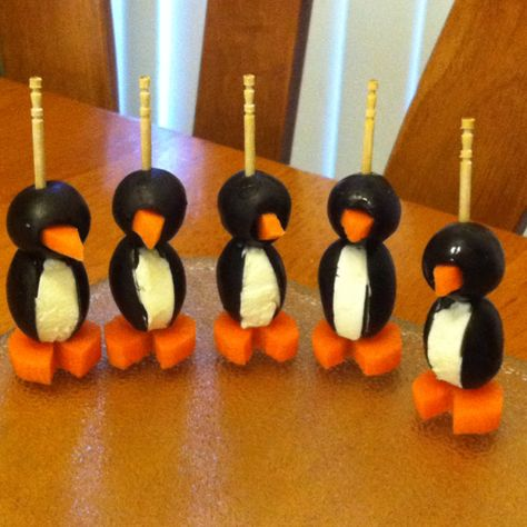 Olive, cream cheese and carrot penguins!