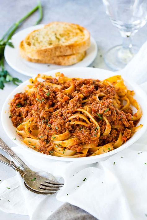 We should have posted The Secret to Authentic Italian Bolognese Sauce Recipe last year after we returned from Italy, but better late than never! You're going to love this rich, meaty sauce! I mean, and don't forget the crusty garlic bread! #PASTA #bolognese #Italian #Italianrecipe #Italianfood #pastarecipe #spaghettisauce #ragusauce #familyfriendly #easyrecipe #familyrecipe #easydinnerrecipe #dinnerrecipe