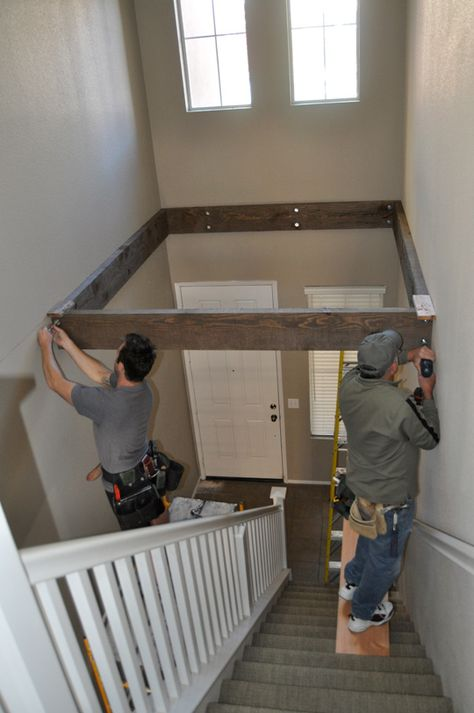 Turn a vaulted entry into playroom or office. Hmmmm...