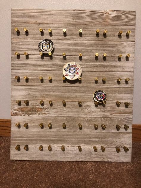 Hand crafted with spent brass casings from LEO trainings. Notice the middle column allows for larger coins. In total it holds 30 coins. Coin Holder Military, Military Shadow Box, Bullet Casing Crafts, Bullet Crafts, Challenge Coin Holder, Challenge Coin Display, Police Challenge Coins, Ammo Crafts, Bullet Art