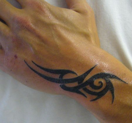 Drake's hand tattoo. By the way, these tattoos are modified to fade when you rub alcohol on them. If you want them to show, you can rub some oil on it and it'll show again.