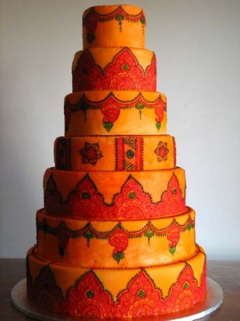 Traditional Indian wedding cake using bold colors . . . .