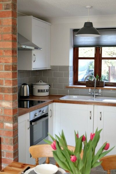 Metro Tile Kitchen oak worktop with sage green metro tiles | k i t c h e n