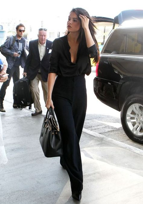 Selena Gomez looks absolutely stunning in a black silk shirt. Can't wait to … Selena Gomez looks absolutely stunning in a black silk shirt. Can't wait to try this outfit idea with our black silk blouse