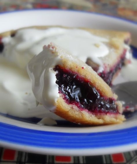 Blackcurrant Plate Pie:  This is a Welsh recipe, known in Wales as cacen blât (literally 'plate cake'). Simple ingredients and very easy to make. Wonderful flavour. Serve warm with some thick cream for a real treat! ~ Going to try with other berries too! MMM  <3