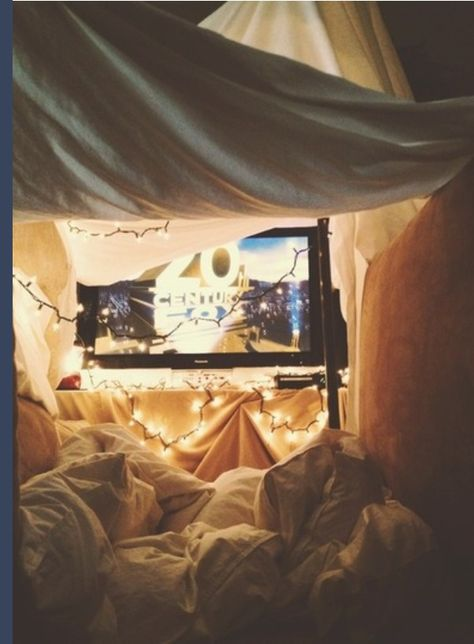 Perfect Date Night Idea! The naughty/good girl in me loves this idea for a date night! build a tent and watch movies.