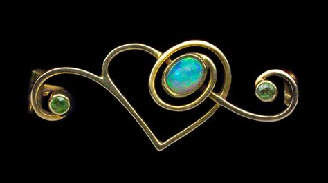 This is not contemporary - image from a gallery of vintage and/or antique objects. MURRLE BENNETT & CO  Art Nouveau Heart Brooch  Gold Opal Peridot