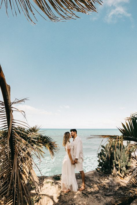 #apparel  #clothing  #plant #man #and #woman  man and woman standing near coconut tree