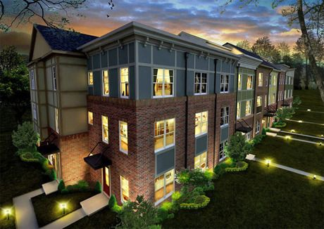 Contemporary townhomes silhouetted against a dramatic sky at dusk. The Boulevard At Brambleton community by Camberley Homes. Ashburn, VA.