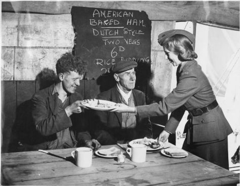 Mrs Cripps, daughter-in-law of Mr Leonard Cripps, serves American baked ham to feed dockyard workers in a marquee being used as an emergency feeding centre on the outskirts of Liverpool. Steak And Seafood, Grilled Seafood, Liverpool Docks, Baked Ham, British History, Going To Work, Blitz, Wwii, Britain