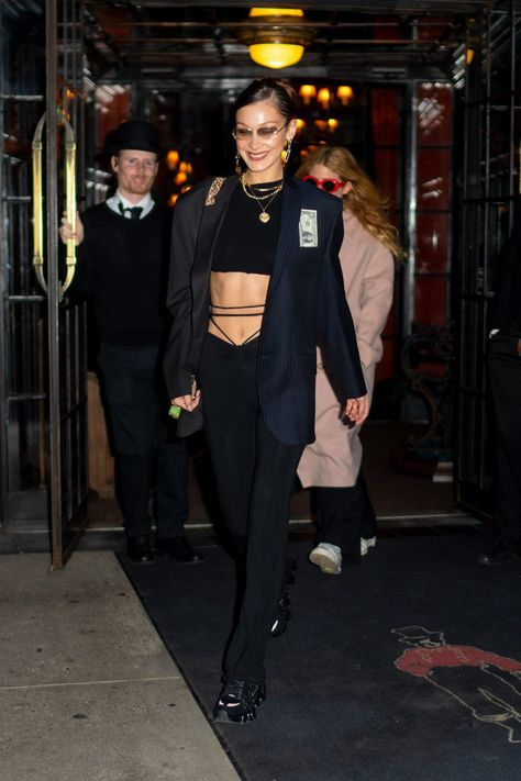 And while Gigi modelled the blazer in a Prince of Wales check, it's actually Bella who first fell for the structured piece in a navy and black colourway – throwing it over a midriff flossing outfit in March before reviving it in December for a night out at Bar Pitti, where she paired it with her beloved Prada Brushed Oxfords. How long until Dua Lipa gets one as an honorary Hadid sister?