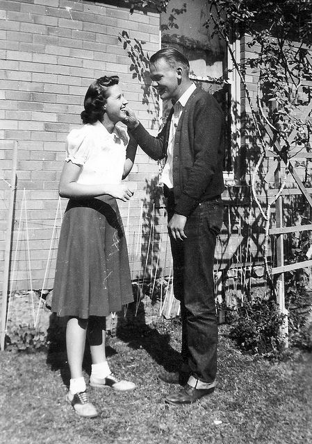 Vintage Photo of a young couple with the woman wearing saddle shoes.