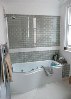 Bathroom Grey Subway Tiles   Inexpensive But Effective   Bath Shorter Than  Wall So Tiled End Shelf Built