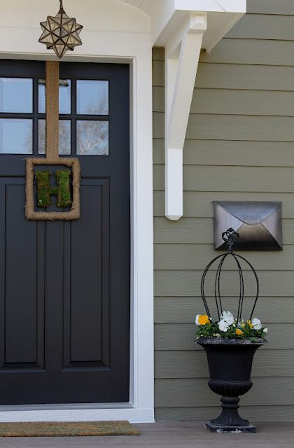 Love color palette-- exterior siding is Crownsville Gray HC-106 by Benjamin Moore...DOOR is painted Benjamin Moore's Aura exterior in black.  That paint is awesome