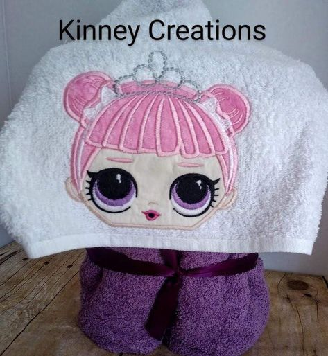 LOL Surprise Center Stage-inspired hooded towel can be used for bath time, poolside or as a beach wrap. HOODED TOWEL- This full-size bath towel with an added hood featuring a Center Stage LOL. The doll is appliqued and embroidery onto the hood part of the towel and sewn onto a purple bath towel. Makes for a unique birthday gift for those little girls who enjoy the LOL show! Machine washable, do not bleach, tumble dry low. BEFORE placing your order, PLEASE•read my Shop Policies.• contact me with