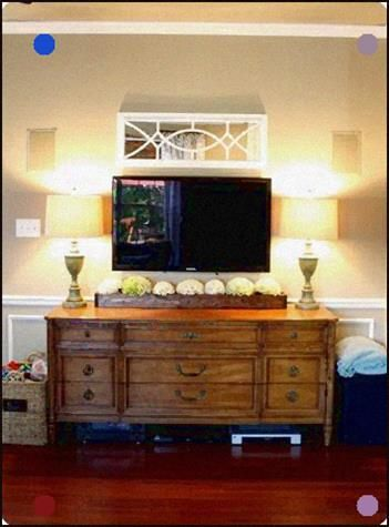 Tv Mounted On Wall Over Dresser Flanking Lamps Pretty Mirror