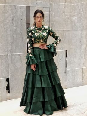 Looking for Beautiful bottle green lehenga with bell sleeved blouse and floral print along with a layered lehenga skirt? Browse of latest bridal photos, lehenga & jewelry designs, decor ideas, etc.