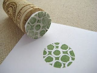 on the cheap: teeny tiny little stampers. Maybe use plastic bottle caps instead of wine corks :)  Could put a large dowel piece inside to make a handle and it would still be cheap.