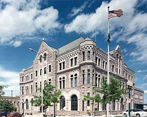 The Sioux Falls U.S. Courthouse is an original 1892 Richardsonian Romanesque style building. The primary exterior building material is a local reddish quartzite and it is used skillfully with different finishes to delineate arched opening and decorative elements.