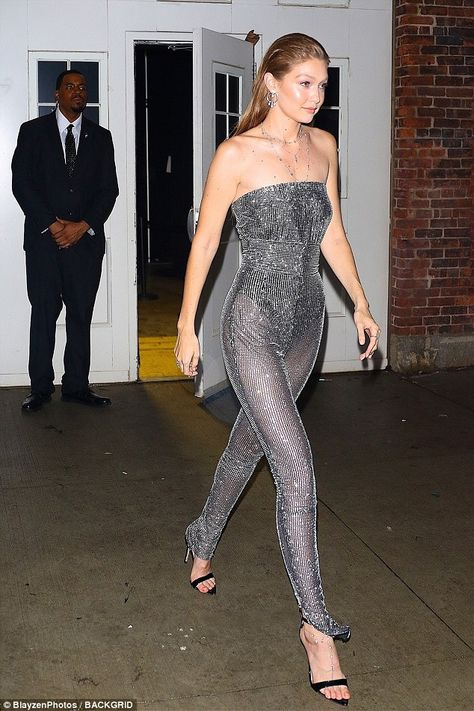 Effortlessly chic: Gigi wore her hair slicked back in a 'wet' hairstyle... #gigihadid
