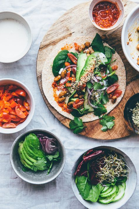 A little pinch of raw cacao powder makes a delicious addition to the warm beans in these #vegan tacos!