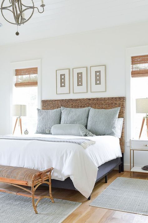 modern coastal bedroom design with rattan headboard and white bedding, coastal master bedroom, cottage bedroom with gray pillows and nightstand decor with artwork over the bed Coastal Master Bedroom, Coastal Bedrooms, Home Decor Bedroom, Bedroom Neutral, Bedroom Modern, Bedroom Ideas, Bedroom Furniture, Bedroom Beach, Light Bedroom